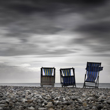 Jonathan Chritchley DECK CHAIRS ON PEBBLE BEACH Seascapes/Beaches
