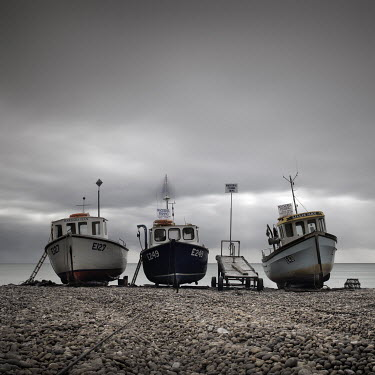 Jonathan Chritchley THREE BOATS MOORED ON PEBBLE BEACH Boats