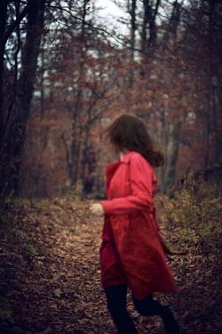 Susan Fox WOMAN RUNNING TROUGH WOODS WITH RED COAT Women
