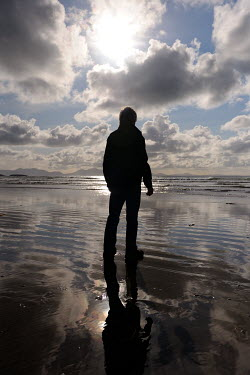 Clint Hughes SILHOUETTE OF MAN STANDING IN SEA Men