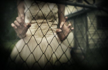 Gary Isaacs WOMAN IN DRESS WITH WIRE FENCE Women
