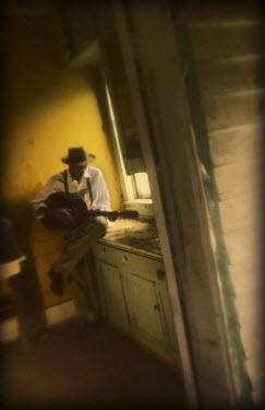 Gary Isaacs BLACK MAN PLAYING GUITAR IN KITCHEN Men