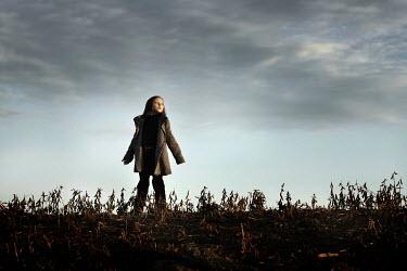 Stephen Carroll GIRL STANDING IN FIELD Children