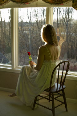 Elisabeth Ansley WOMAN SITTING BY WINDOW, HOLDING ROSE Women