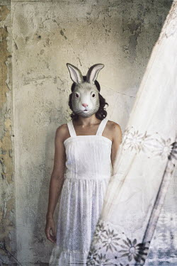 Samantha Nandez Woman wearing a rabbit mask Women