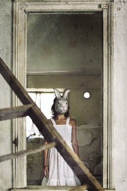 Samantha Nandez Woman in old house wearing rabbit mask Women