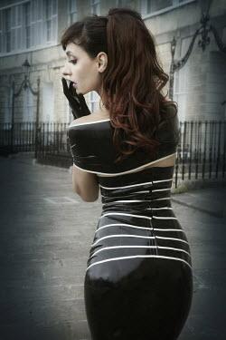 Emma Delves-Broughton Woman in latex dress Women