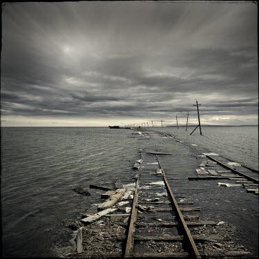 Christophe Dessaigne EMPTY FLOODED RAILWAY TRACKS Railways/Trains
