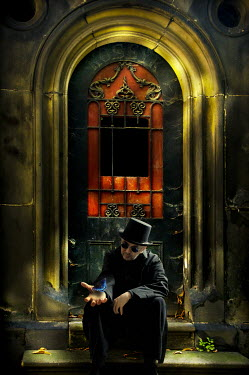 Valentino Sani MAN IN HAT SITTING BY DOOR WITH FEATHER Men
