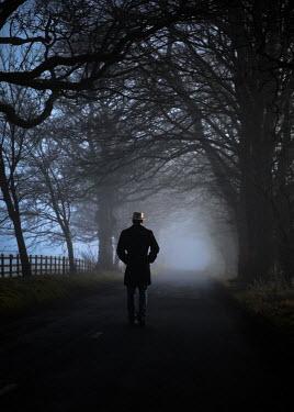 Neil Denham MAN IN HAT STANDING IN COUNTRY LANE Men