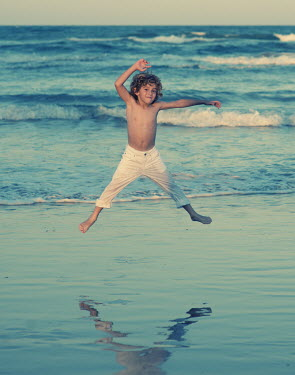 Vanesa Munoz BLONDE BOY JUMPING ON BEACH Children