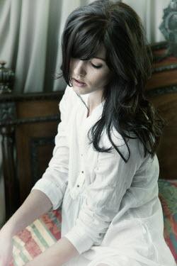 Yolande de Kort woman sitting on a bed Women