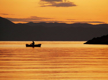 Katarina Ivicevic MAN IN BOAT ON LAKE WITH SUNSET Men
