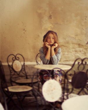 Marta Syrko TEENAGER SITTING IN CAFE Children