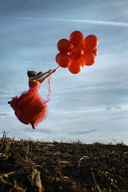Stephen Carroll WOMAN FLOATING WITH RED BALLOONS Women