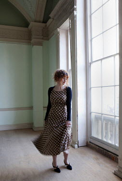 Lesley Aggar WOMAN IN SPOTTED DRESS BY WINDOW Women