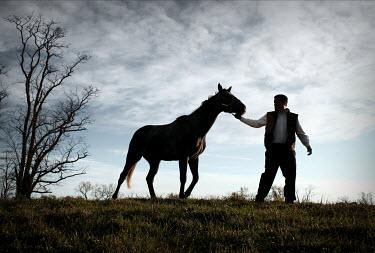 Stephen Carroll MAN LEADING HORSE IN FIELD Men