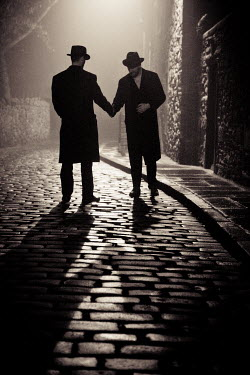Laurence Winram TWO MEN SHAKING HANDS IN COBBLED STREET Men