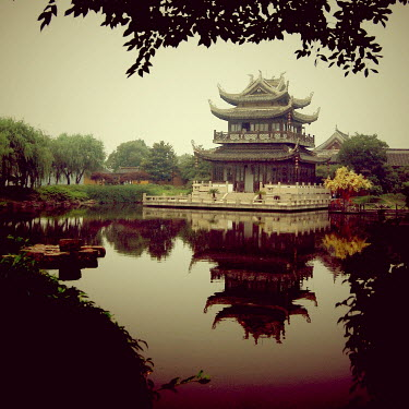 Jean Fan PAGODA ON LAKE WITH TREES Religious Buildings