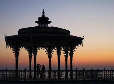 Lauren Leake-Lyall COUPLE SILHOUETTED IN BANDSTAND Couples