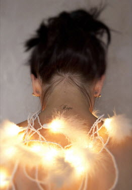 Lauren Leake-Lyall BACK OF WOMAN WITH LIGHTS AND TATTOO Women