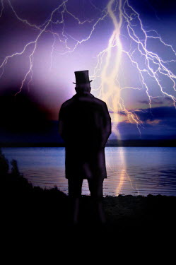 Maggie Brodie MAN IN TOP HAT BY LAKE WITH LIGHTENING Men