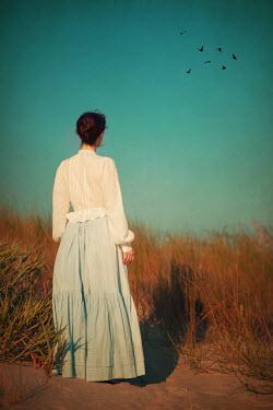 Susan Fox VICTORIAN WOMAN STANDING IN DUNE WATCHING BIRDS Women