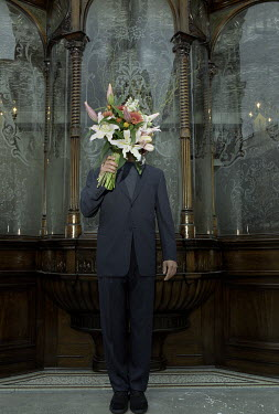 Richard Dunkley MAN STANDING WITH BOUQUET OF FLOWERS Men