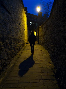 Richard Dunkley WOMAN WALKING IN ALLEY AT NIGHT Women