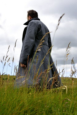 Sally Mundy MAN IN COAT WALKING IN FIELD Men