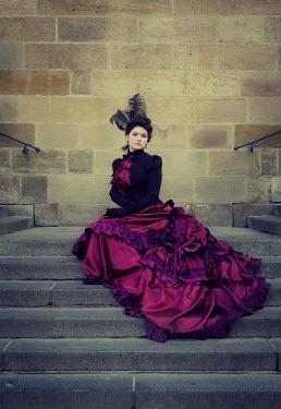 Katya Evdokimova WOMAN IN PURPLE DRESS ON STEPS Women
