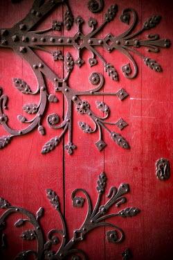 Jacinta Bernard RED DOOR WITH ORNATE HINGES Building Detail