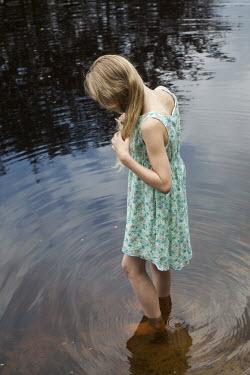 Yolande de Kort GIRL PADDLING IN SUMMER DRESS Children