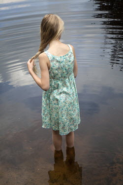 Yolande de Kort BLONDE GIRL PADDLING IN RIVER Women
