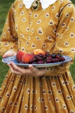 Elisabeth Ansley WOMAN HOLDING BOWL OF FRUIT Women