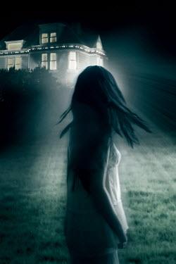 ILINA SIMEONOVA WOMAN LOOKING AT OLD HOUSE AT NIGHT Women