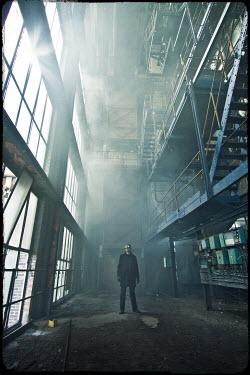 Christophe Dessaigne man in goggles in factory Men