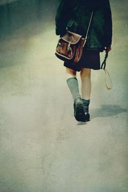 Mark Owen schoolboy with satchel and catapult Children