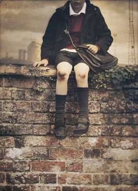 Mark Owen schoolboy sitting on wall with satchel Children