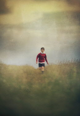 Mark Owen SCHOOLBOY IN RED JUMPER IN FIELD Children