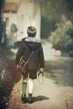 Mark Owen SCHOOLBOY WALKING IN VILLAGE WITH CATAPULT Children