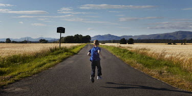 Emma Delves-Broughton BOY RUNNING IN COUNTRYSIDE Children