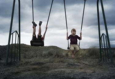 Emma Delves-Broughton TWO CHILDREN ON SWINGS Children