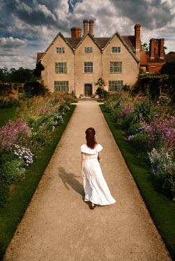 Michael Trevillion WOMAN WALKING ON PATH TO HOUSE Women