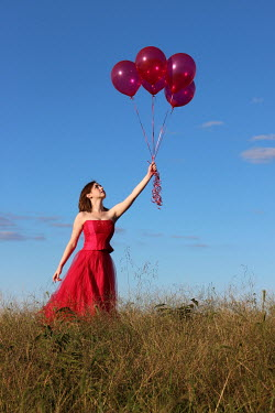 Stephen Carroll WOMAN IN RED WITH BALLOONS Women