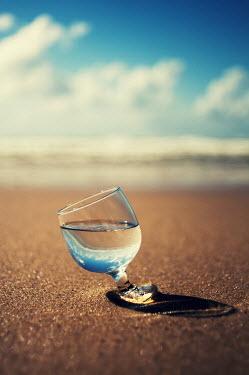 Aurelie Sarramon GLASS OF WATER ON SANDY BEACH Miscellaneous Objects