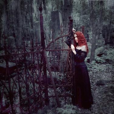 Karolina Kumorek WOMAN WITH RED HAIR IN GRAVEYARD Women