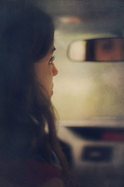 Susan Fox GIRL LOOKING IN CAR MIRROR Women