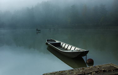 Carmen Spitznagel BOAT MOORED ON STILL LAKE Boats