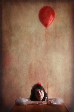 Romina Dughero WOMAN LOOKING AT RED BALLOON Women